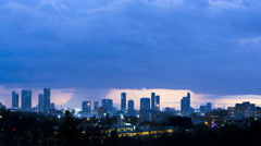 Time lapse storm Skyline Cloudscape sunset view of City buildings apartments and Stock Footage