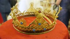 Close up of gold wedding crowns with sapfire, rubin and brilliant prepared for Stock Footage