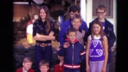1974: group of children along with woman standing in front of house LINCOLN Stock Footage