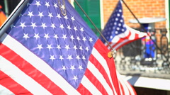 American Star and Stripes flying proudly outdoor Downtown historic French Stock Footage