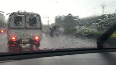 POV driving in hard rain on the street in Bangkok, Raining on windshield. Stock Footage
