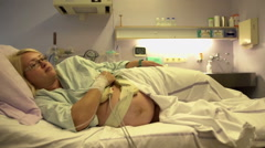 Pregnant woman is resting and will give birth soon Stock Footage