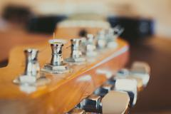 Electric guitar headstock and chords detail, music symbol Stock Photos