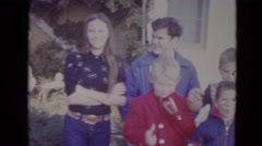 1974: large family of happy children standing in front of brick home LINCOLN Stock Footage