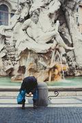 Addicted person in urban historic fountain Stock Photos