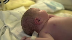 Putting a diaper on a new born baby Stock Footage