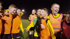 March 2016. Happy youth soccer team celebrate at the end of a game Stock Footage