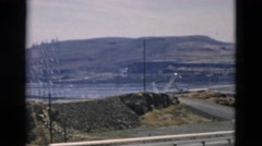 1958: many roads and bridges lead to and from hydroelectric dam. OREGON Stock Footage