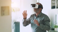 Mature business man wearing virtual reality googles / VR Glasses Stock Footage