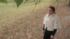 Sad young woman walking in autumn Park Stock Footage