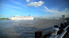 New Orleans, USA - September 2016: Cruise ship by Crescent City Connection Arkistovideo