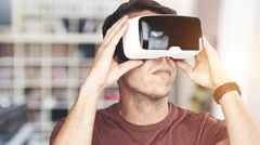 Young man wearing virtual reality googles / VR Glasses  Stock Footage