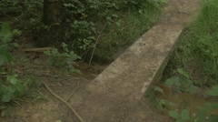4k Small Stone Bridge Over Stream In Woodland Countryside Stock Footage