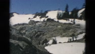 1958: cars travelling through mountain range with snow peaks OREGON Stock Footage