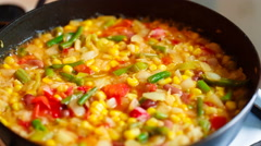 Cooking frozen vegetables in a pan Stock Footage