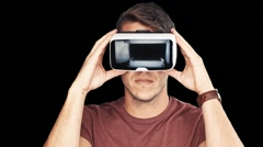 Close up shot of a young man wearing virtual reality googles / VR Glasses Stock Footage