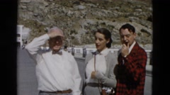 1958: random odd wealthy characters visiting tourist destination national park Stock Footage