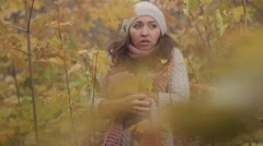 Girl Squeezes your Hands from Cold in Autumn Park Stock Footage