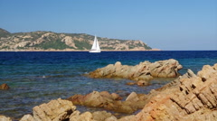 White sailboat near the coast of Sardinia Stock Footage