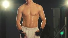 Sweaty boxer training kicks in the gym. Slowly Stock Footage