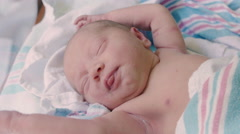 Close Up of Newborn Baby in Hospital Stretching and Sleeping Stock Footage