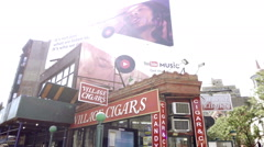 Village Cigars shop on Christopher Street by 1 subway train station NYC Stock Footage