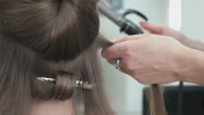 Professional stylist makes the curls to a girl Stock Footage