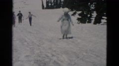 1958: couple walking up glacier ice melt in summer time to take picture WYOMING Stock Footage