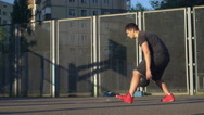Handsome basketball player training outdoors Stock Footage