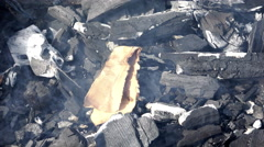 Heat transfer from the hot coals and ignite the paper in the wind Stock Footage