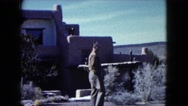 1960: person standing in front of home looking around. NEW MEXICO Stock Footage