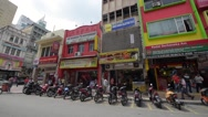 A pan shot of the city center in the Chinatown area known as Petaling Street Stock Footage
