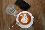 Table with cup of coffee, glass of water and smartphone top view Stock Photos