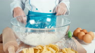 Close up hands of young baker in the flour at the kitchen table Stock Footage