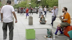 Talented street performer singing for crowd in Washington Square Park in NYC 4K Stock Footage