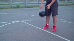 Guy training dribble at the sports ground Stock Footage