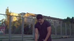 Handsome guy plays with ball at the playground Stock Footage