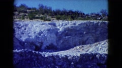 1960: view of mountain mining operation covered with layers of gravel and rocks Stock Footage