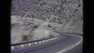 1960: deserted dry road trip across rugged cliff hugging landscape NEW MEXICO Stock Footage