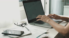 Woman working on laptop at home interier Stock Footage
