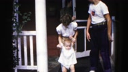 1962: family taking children for walk in the frontyard HAGERSTOWN, MARYLAND Stock Footage