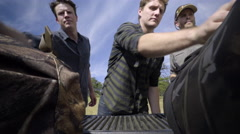 Hunters Open Tailgate And Unpack Truck Together For Hunting Trip Stock Footage