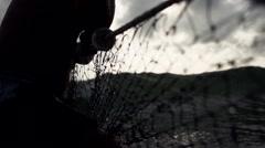 Fishermen pulling net at sea Stock Footage
