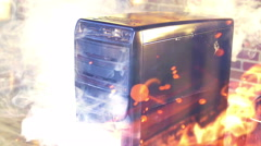 Computer on fire burning Stock Footage