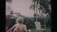 1962: adorable white blonde kids pulled around on red wagon rider HAGERSTOWN Stock Footage