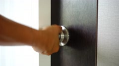 The key is inserted into the keyhole of the door of the house and open. Stock Footage