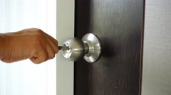 The key is inserted into the keyhole of the door of the house and open Stock Footage