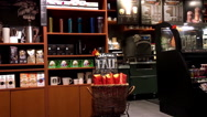 Pan shot of people ordering coffee and chatting inside Starbucks store Stock Footage