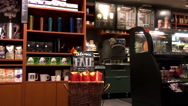 Pan shot of people ordering and waiting coffee inside Starbucks store Stock Footage