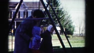 1962: little girls with their mom on swing HAGERSTOWN, MARYLAND Stock Footage